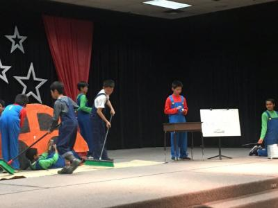students performing STOMP