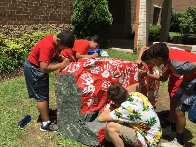 6th graders working on kindness rock