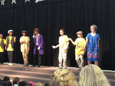 students performing Willy Wonka