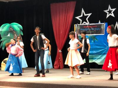 students performing Grease