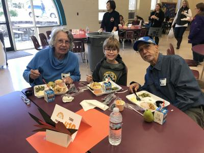 families enjoying thanksgiving lunch