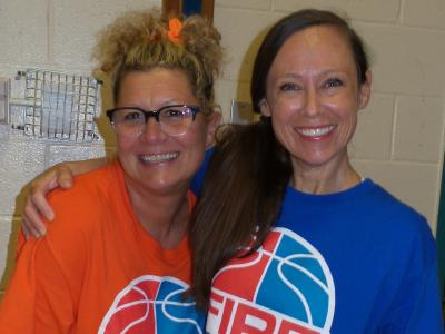 two teachers play on opposite fire and ice teams